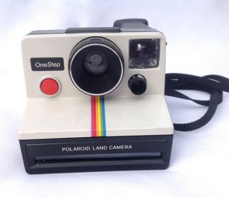 Vintage style 1980's polaroid camera. Uses SX-70 film. Good way to Instagram without Instagram.