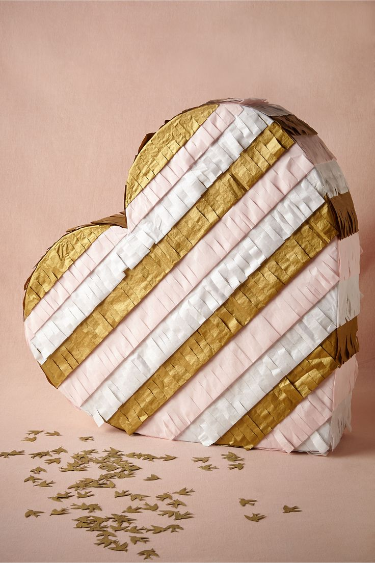 LMAO! Ridiculous and I kinda love it. One way to tie in my mexican heritage... Fringed Heart Piñata from BHLDN