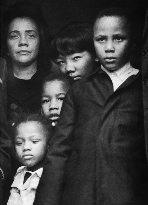 Mrs. King and her four children flew from Memphis back to Atlanta with Dr. King's body for burial. As Dr. King's body was being taken from the plane, there was just a moment when the family came together in the doorway. - by Harry Benson