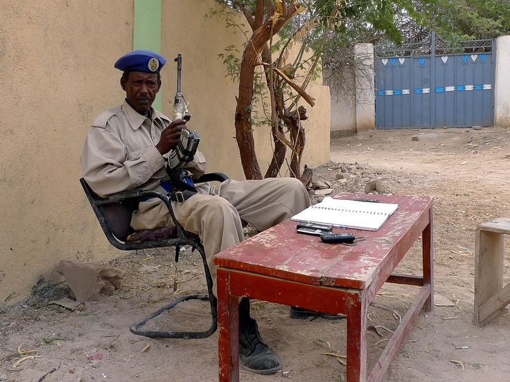 https://flic.kr/p/7NoA3Y | Hargeysa (Somaliland/Somalia) - Guard | There are lots of security checks all over Hargeysa (as a reaction after the 2008 terrorist attacks). When entering buildings of NGOs and international organisations, there's always a thorough check with metal detectors and the like. The same for entering the hotel. And many places are guarded by guards with kalashnikovs. The guard in the picture sits in front of the Ethiopian liaison office to Somaliland, the only…