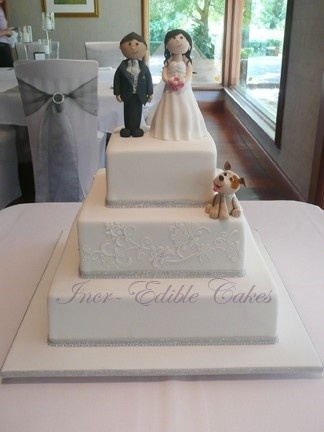 Three tier square wedding cake with fondant Bride, Groom and dog. by dianne
