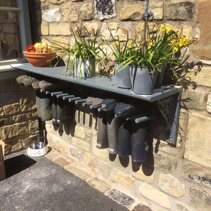 Need this! Wellington boot rack with a shelf...