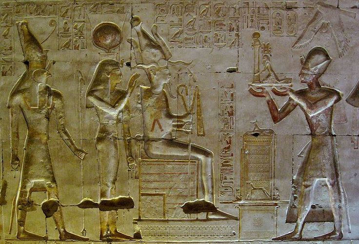 Ramses II Before the gods Osiris, Isis and Horus in the mortuary temple of Seti I. at Abydos.