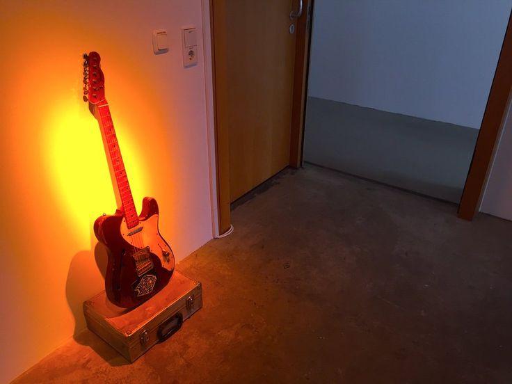 "A guitar in the display dedicated to ID cards of Ali Ibrahim ""Ali Farka"" Touré, at documenta 14. Image: Ben Davis."
