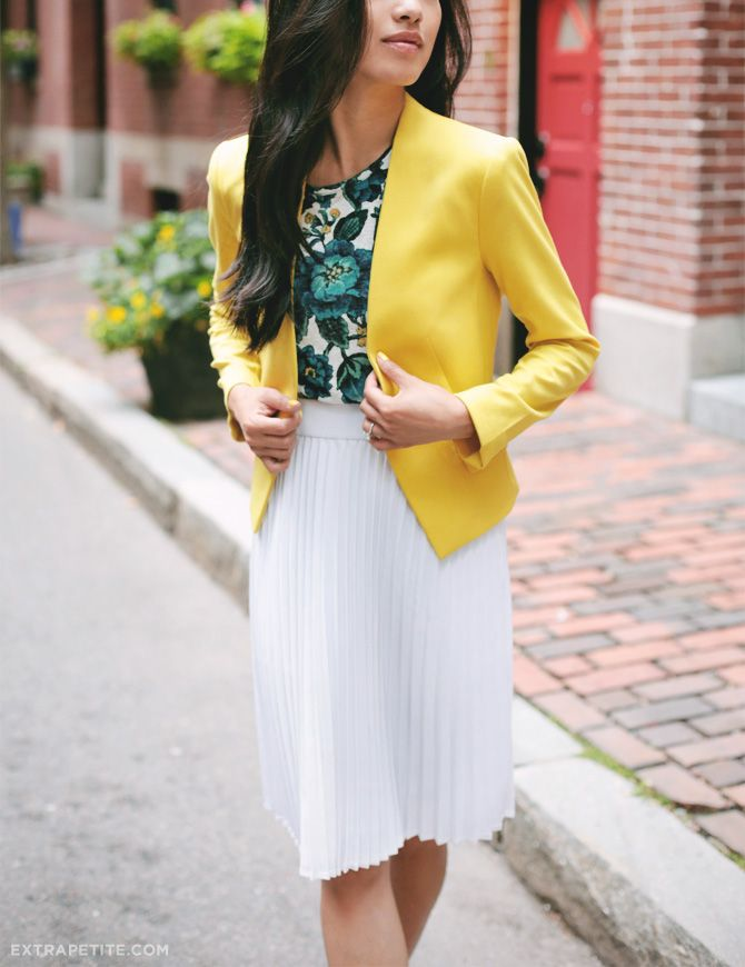 classic but colorful spring-summer work outfit // white skirt, floral top, yellow blazer for business casual. More outfit ideas on extrapetite.com