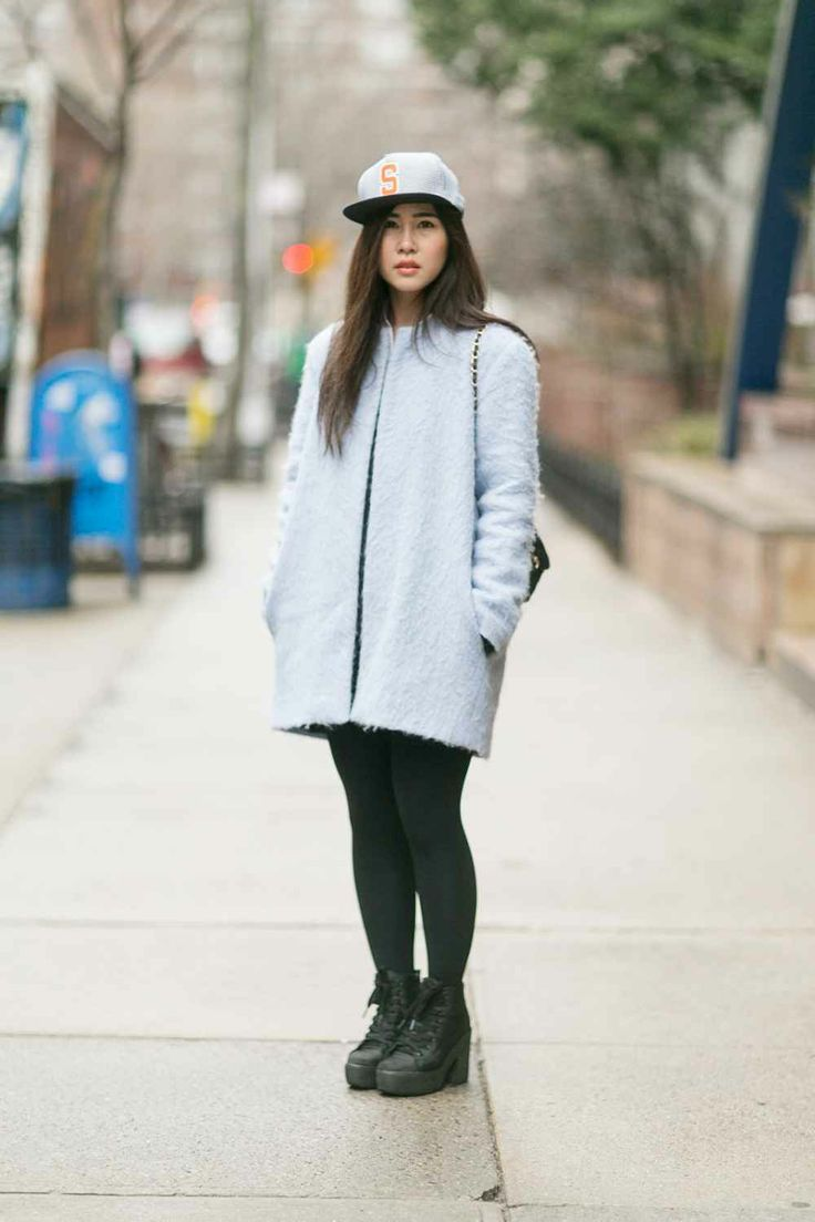 Prospective F.I.T. student Emmy Chorphaka wears a Supreme hat, a Zara coat, and boots from a boutique in Soho.