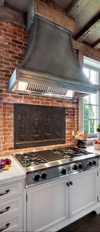 rustic kitchen with exposed wood beams brick walls and blue star rh pinterest com