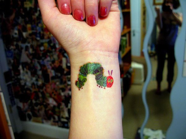 Very Hungry Caterpillar tattoo. This one is cute...some of these other children's book tattoos are a bit...too intense.