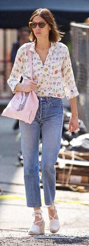 Retro style: The TV star and designer showed off her keen fashion sense in a print shirt a...
