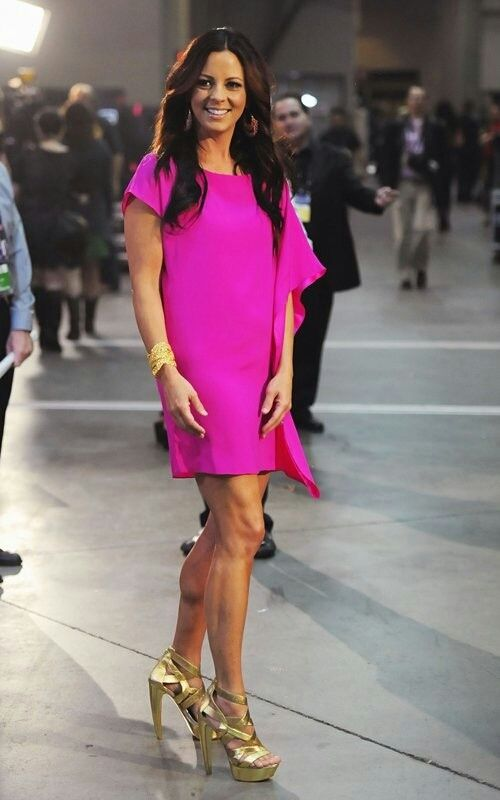 Sara Evans stunning legs in a short pink dress and gold platform strappy high heels.