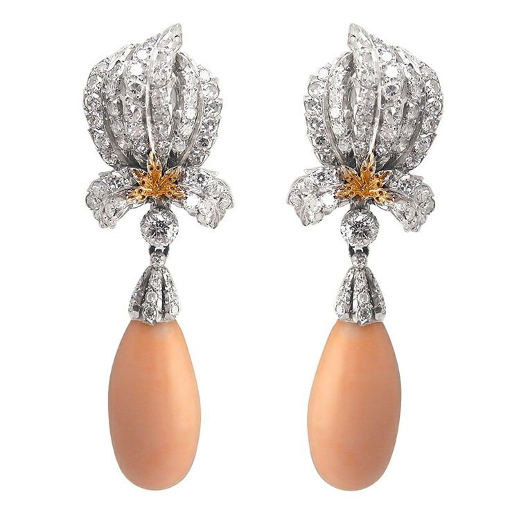 BUCCELLATI  --  Platinum & 18 kt. gold pendant earrings set with brilliant-cut diamonds, suspending angel skin coral drops. Coral is detachable. Circa 1960s