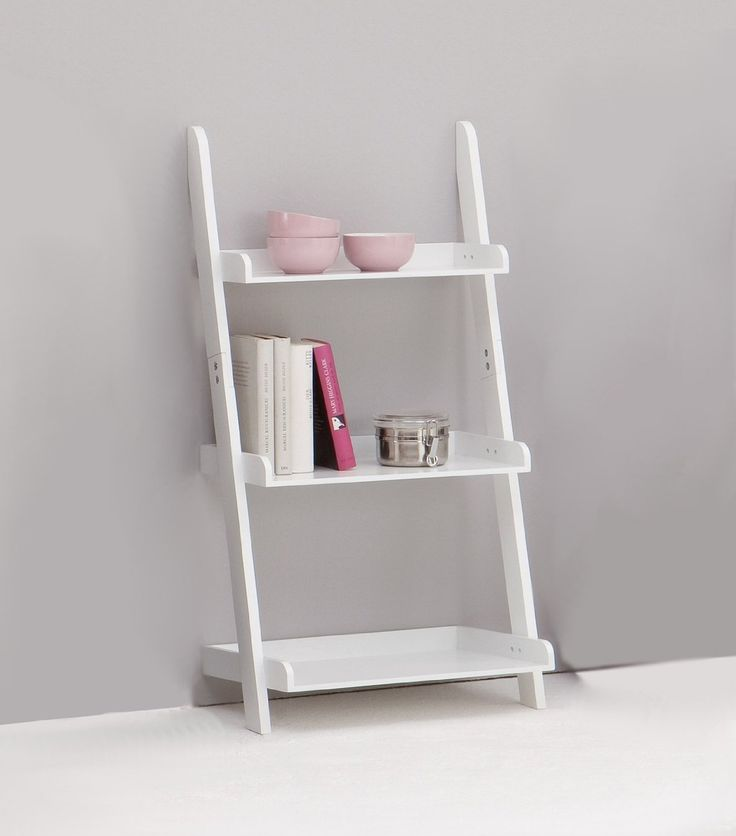 Using a ladder shelf to save some space is one of the many ways to save a small bathroom space.