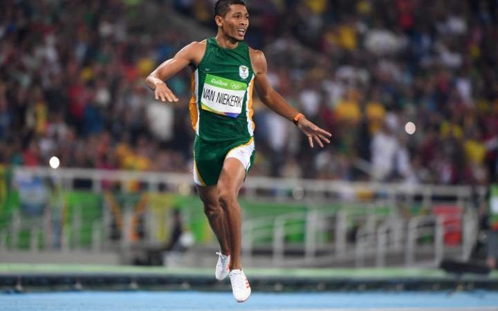 South Africa's Wayde van Niekerk crosses the finish line to break the world record in the Men's 400m Final during the athletics event at the Rio 2016 Olympic Games at the Olympic Stadium in Rio de Janeiro on August 14, 2016