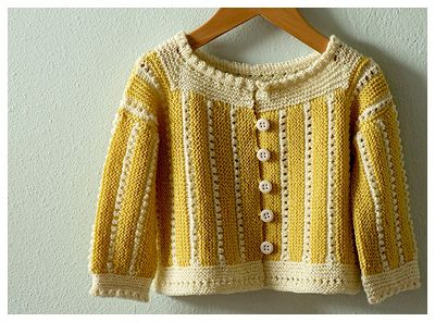 another great knit sweater...... Lemon Meringue.  PATTERN: Liza Sideways Saque by Kristin Rengren from the book Vintage Baby Knits: More Than 40 Heirloom Patterns from the 1920s to the 1950s. In case I learn to knit!