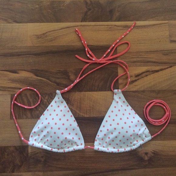 Women's peach and white polka dot bikini top Padded triangle bikini top with white and peach polka dots from Victoria's Secret. Victoria's Secret Swim Bikinis