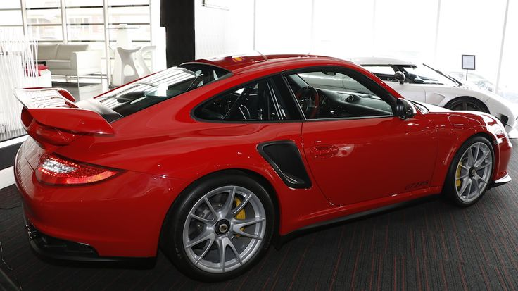 The fastest and most powerful road car Porsche has ever produced. In comparison to the existing 911 GT2, the RS has 90 bhp more and weighs 70 kilograms (154 lb) less, consumes 5% less fuel at 11.9 ltr/100 km (equal to 23.7 mpg) and emits 5% less CO2 at 284 g/km. It's the blistering performance … Continue reading PORSCHE 911 GT2 RS 1 of 500 →