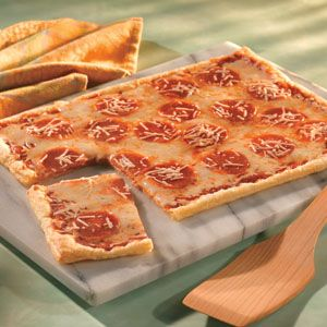traditional pepperoni pizza gets a delicious twist when it's made with a golden and flaky puff pastry crust