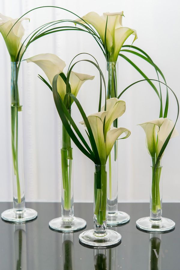 Cool.  Grasses with flowers in vases. May need to cut up grasses into smaller strands.