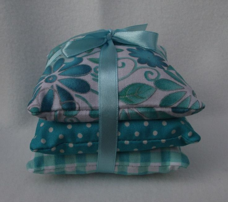This pretty trio of pillows are handmade in a fresh cotton fabric in shades of white & aqua / turquoise, floral, gingham & dots and finished off with a satin ribbon. The pillows are filled with Aromatic English Lavender. The size of each cushion is approx. 9cm square. Thse lovely pillows will keep your drawers smelling nice or could be placed in a room for a lovely fresh fragrance and would make a lovely gift.  PRICE £5.00 + P&P