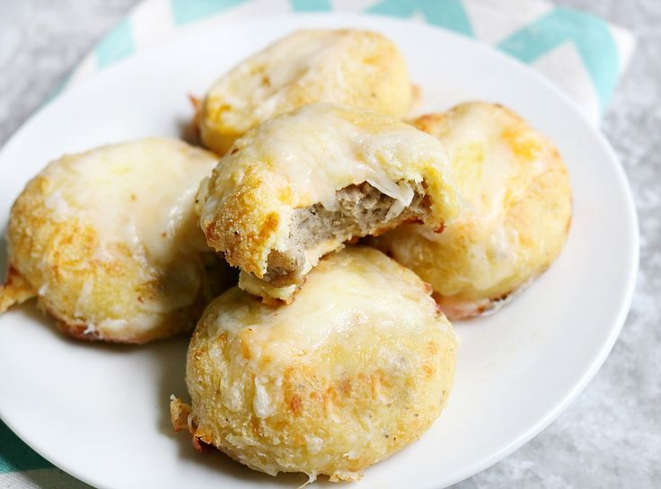 Keto Breakfast biscuits hugging gooey, melty cheese and breakfast sausage. Perfect for those who are not a fan of eggs! Freeze and eat all week.