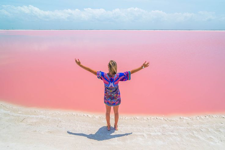 Las Coloradas Yucatan Pink Lake in Mexico, girl standing at the lake