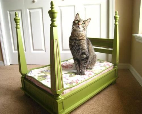 Upcycle an old table with some scrap wood, paint and vintage fabric into a poster bed for your favorite cat or dog!