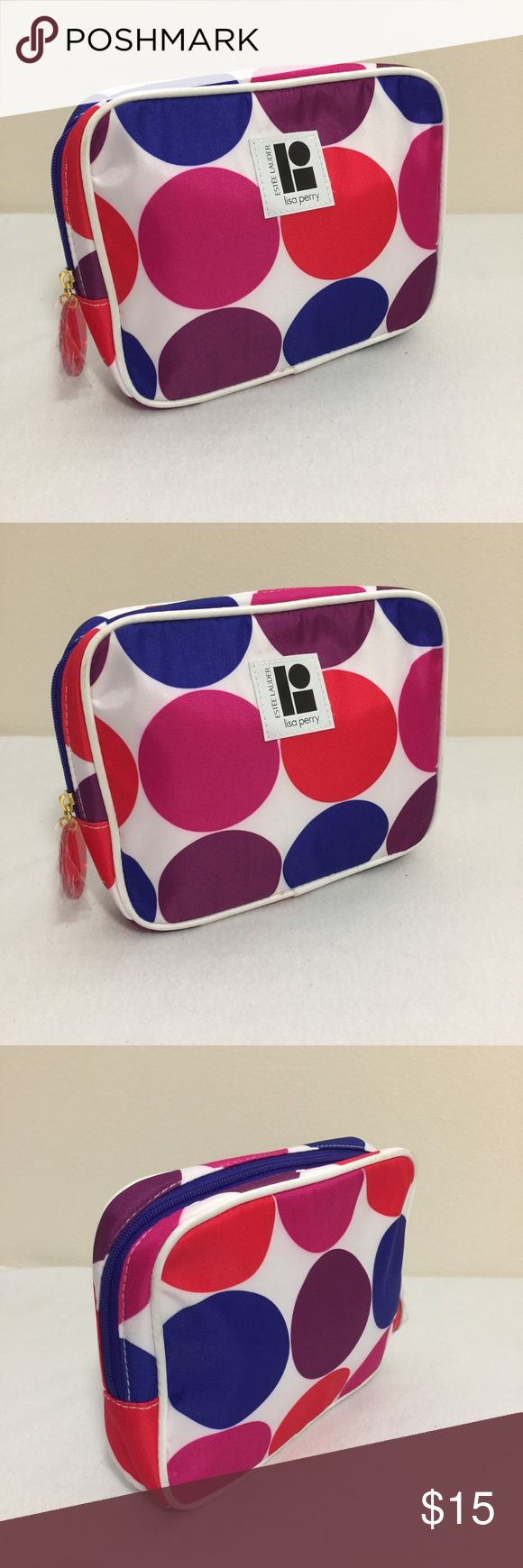 """Estee Lauder Lisa Perry Make Up pouch Multicolor Estee Lauder Lisa Perry Polka Dot Print Make Up pouch Cosmetic bag 6"""" height Measurements: Bag Height: 6"""" Bag Depth: 1 1/2"""" Bag width: 7 1/4"""" Condition: NEAR NEW  We try to describe the product true to its condition. However, personal opinions about the product condition may vary. Please message us with any questions Estee Lauder Makeup"""