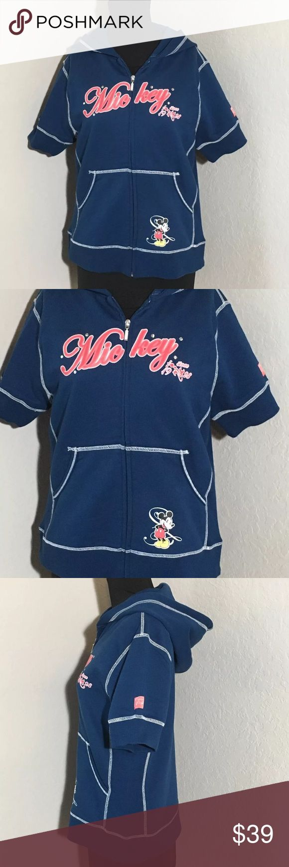 """Disney Mickey Mouse Short Sleeve Hooded Sweater M Women's Disney Direct short sleeve Mickey Mouse navy blue full zip up hooded sweater. Size M 20"""" armpit to armpit, 23.5"""" shoulder to hem. Excellent condition no flaws Disney Tops Sweatshirts & Hoodies"""