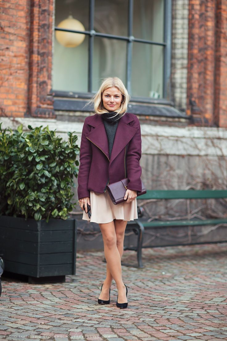 plum jacket over chunky knit sweater over dainty skirt. purple clutch, basic black heels