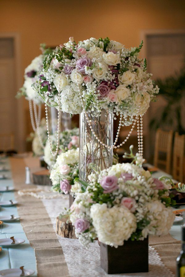 make your own wedding flower centerpieces%0A Pastel wedding flowers  tall vase arrangement with draping pearls  A farm  wedding with beautiful