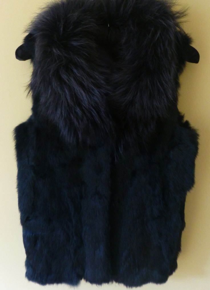 A fox fur collar and rabbit body satin lined gilet in a wonderful ink blue hue.  One left in a size medium (UK:  12) Contact:  wolffboutiquefashion@gmail.com