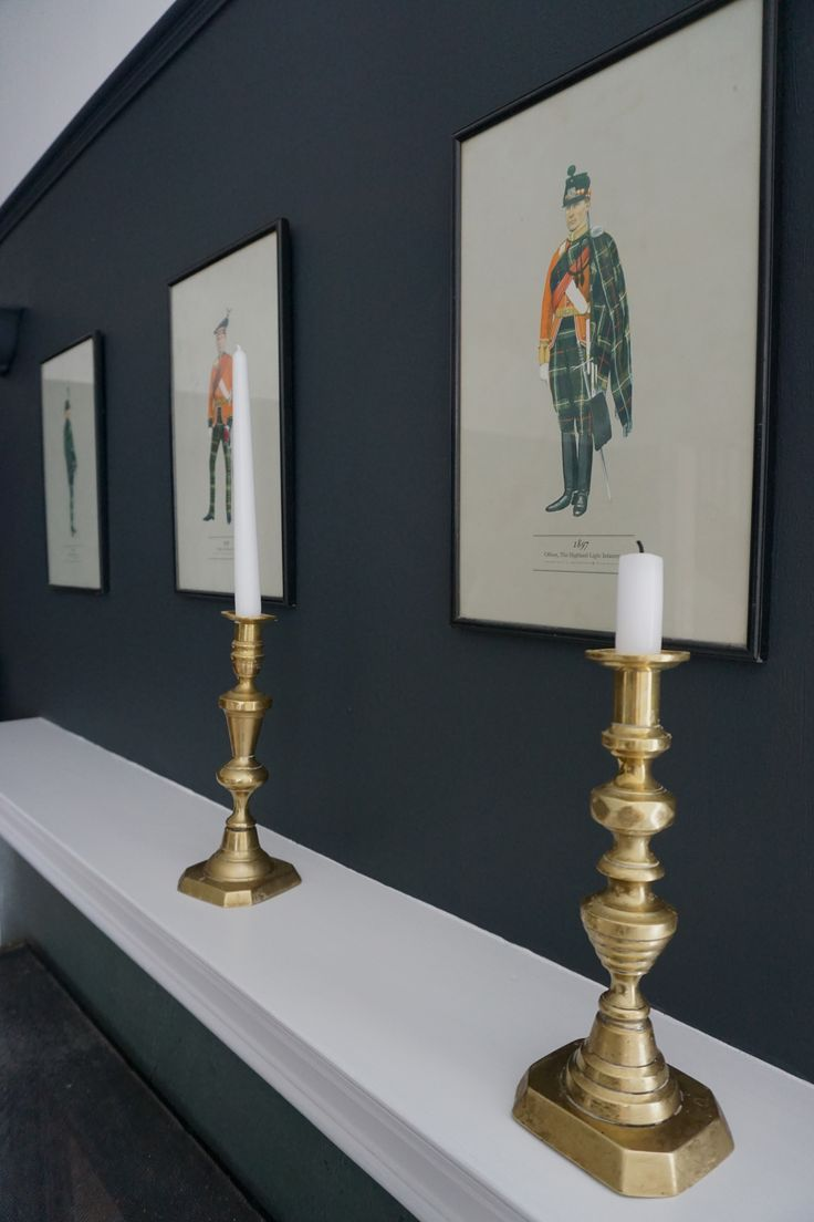 Dark dining room, brass candlesticks