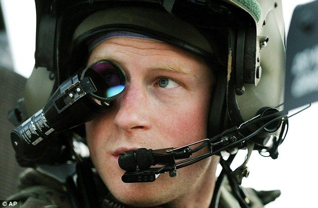 Top gun: Prince Harry wears his monocle gun sight as he sits in the front seat of an Apache preparing to take off from Camp Bastion southern Afghanistan in December last year