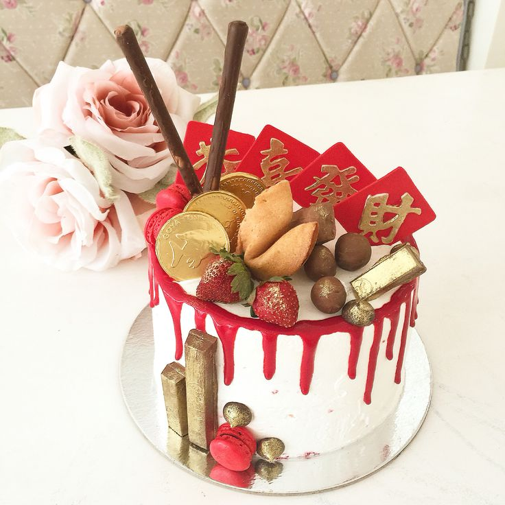 Barrel drip cake for the Chinese New Year , red velvet cake with cheesecake filling