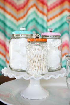 Pretty Bathroom Jars - pickle jars received a makeover into pretty storage jars