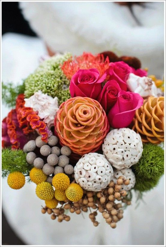 Beehive ginger, craspedia, berzillian baubles, cockscomb, pin cushion protea, green dianthus, trichillium, roses