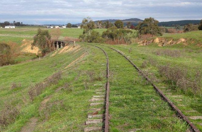 This line of track is on its way to becoming NSW's first state-sponsored rail trail: http://cycletraveller.com.au/australia/news/tumbarumba-trumps-byron-bay-for-nsw-rail-trail-funding
