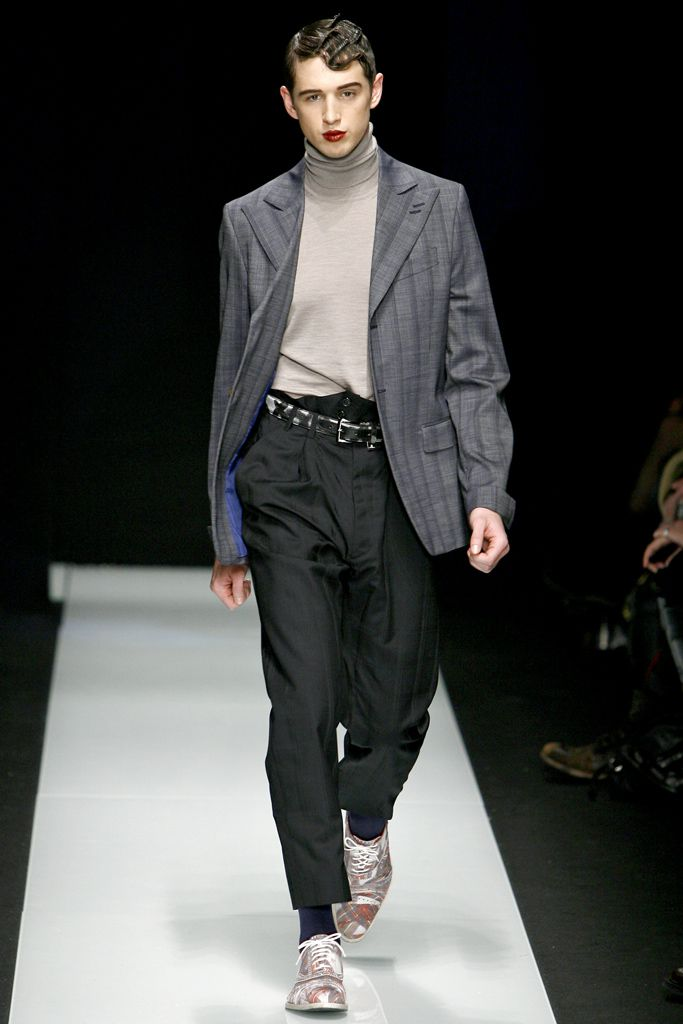 The padded shoulders, long jacket, and high waisted baggy pants are similar to that of the Zoot Suit worn in the 1930s. This ensemble by Vivienne Westwood are inspired by the zoot suit during this time, though not exactly identical, you do see the similarities. Zoot suits during the 1930s-1940s had baggy pant legs, however, compared to today's fashion, these pant legs are quite large. 2/28/1