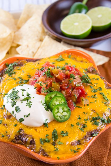 Recipe For Hot Mexican Bean Dip - This bean dip is sooooo good. It is easy to make and is always a hit. I make it for my Super Bowl party each year and it is always gone before half time!