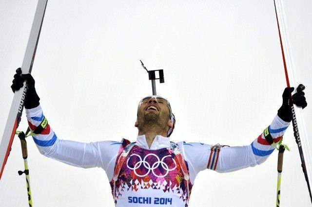 OLY-2014-BIATHLON-MEN Rosa Khutor / Venäjä - 10.02.2014 France's Martin Fourcade celebrates as he wins gold in the Men's Biathlon 12,5 km Pursuit at the Laura Cross-Country Ski and Biathlon Center during the Sochi Winter Olympics on February 10, 2014 in Rosa Khutor near Sochi.   Copyright: AFP / Lehtikuva Lähde: AFP Kuvaaja: Odd Andersen