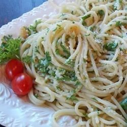 Spaghetti Aglio e Olio is a simple Italian dish of garlic, olive oil, parsley, and Parmigiano-Reggiano cheese tossed with cooked pasta.
