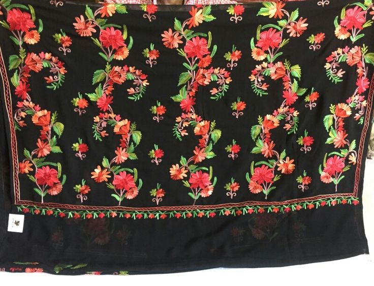 Black saree with red green embroidery