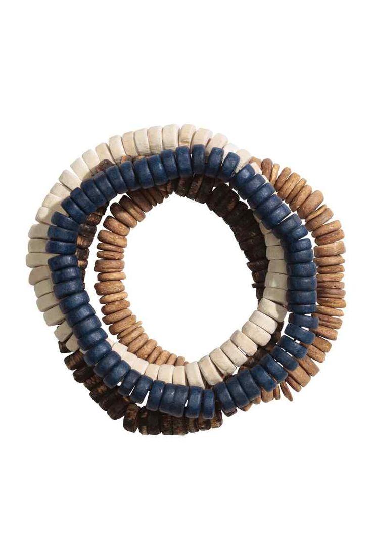 4-pack bracelets: Elastic bracelets with wooden beads.