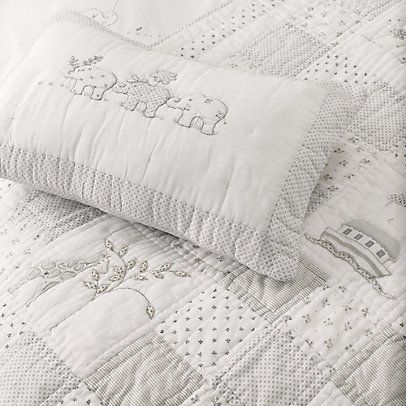The simplicity of the white is so beautiful!                                     Noah's Ark Cot Bed Quilt   The White Company