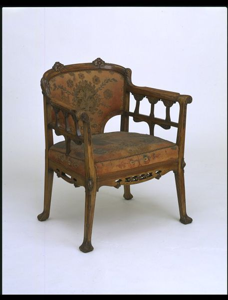 Odön Faragó (1869-1935) - Arm Chair. Carved & Patinated Ash with Felt Seat & Back with Coloured Leather Appliqués and Silk Cording. Made by Lörincz Lengyel. Szeged, Hungary. Circa 1898. 83cm x 69.5cm x 62.5cm.