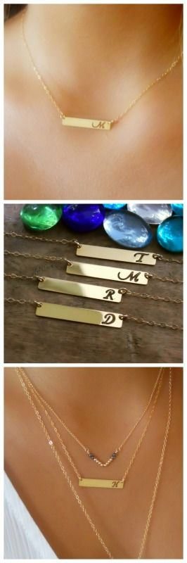 A beautiful, delicate gold initial bar necklace. Romantic and classic letters that are cut out.