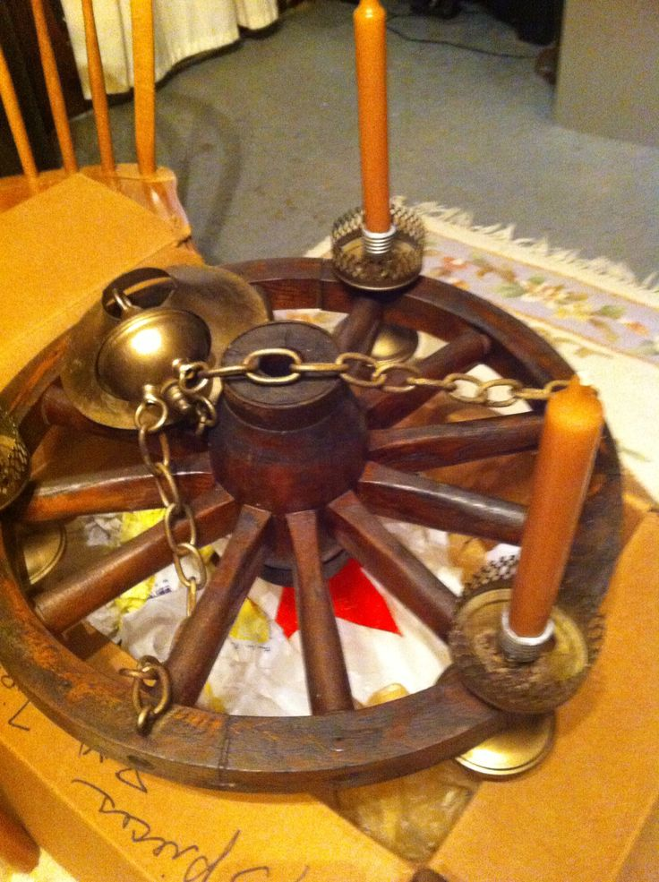 Turn an old wagon wheel light fixture into a chic for Things to do with old wagon wheels