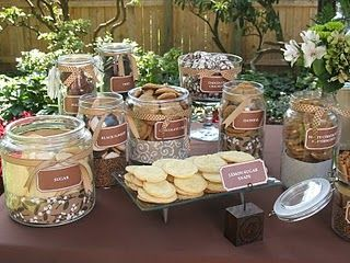 A Cookie Bar!  Guests can select cookies and place them in a cute package to take home as favors!  I like it!