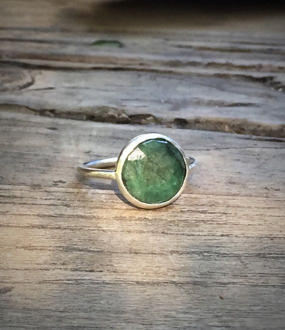 All natural emerald gemstone, lightly faceted. Handmade sterling silver bezel setting. Open back, emerald shows on both sides. Any size, made to