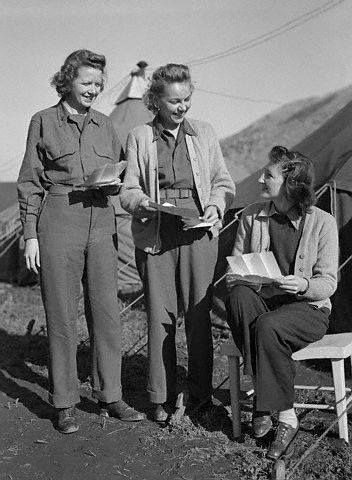 14 February 1944, Italy - Three US Army nurses attached to an evacuation hospital behind the fifth army fighting front get one of their biggest treats when mail brings letters from home. They are (L-R) Lt. Dorothy E. Fischer, Pittsburgh, PA.; Lt. Mary A. Matock of Cumbolo, PA., and Lt. Helen Richert, Irvington, PA. They are in off duty attire ~